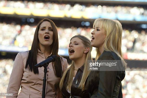 The Dixie Chicks perform the National Anthem before the start of Super Bowl XXXVII between the Tampa Bay Buccaneers and the Oakland Raiders on...