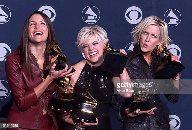 The Dixie Chicks play around with their Grammy awards for Best Country Album and Best Country Performance for a Duo or Group at the 42nd Annual...