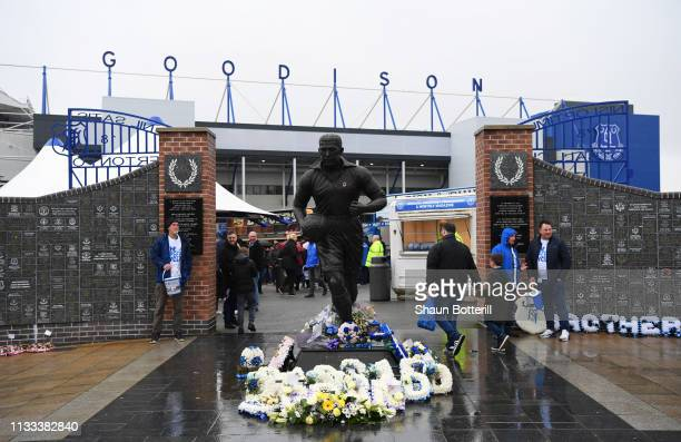 The Dixie Dean statue is seen outside the stadium prior to the Premier League match between Everton FC and Liverpool FC at Goodison Park on March 03...