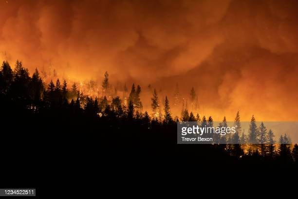The Dixie Fire burns on a mountain ridge sending embers into the air on August 5, 2021 in Greenville, California.