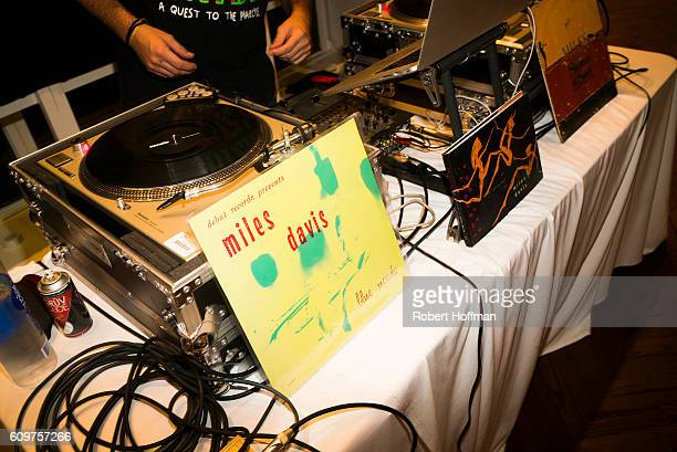 The DJ booth displaying records of Miles Davis at the opening of Next Level Badass in Chicago Illinois