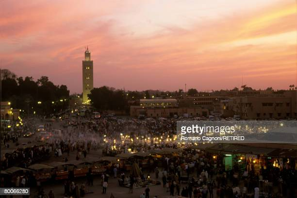 The Djemaa el Fna square in Marrakech at sunset with the Koutoubia Mosque in the background circa 1980