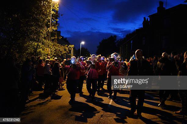 The Dobcross Brass Monkeys band compete in the Whit Friday brass band competition in the village of Dobcross near Oldham northern England on May 29...