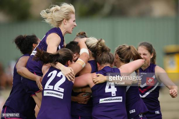 The Dockers celebrate after the teams win during the round three AFLW match between the Fremantle Dockers and the Melbourne Demons at Fremantle Oval...