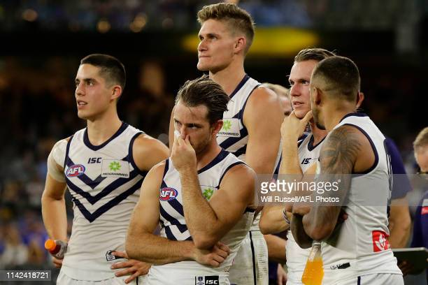The Dockers look on after the teams defeat during the round four AFL match between the West Coast Eagles and the Fremantle Dockers at Optus Stadium...