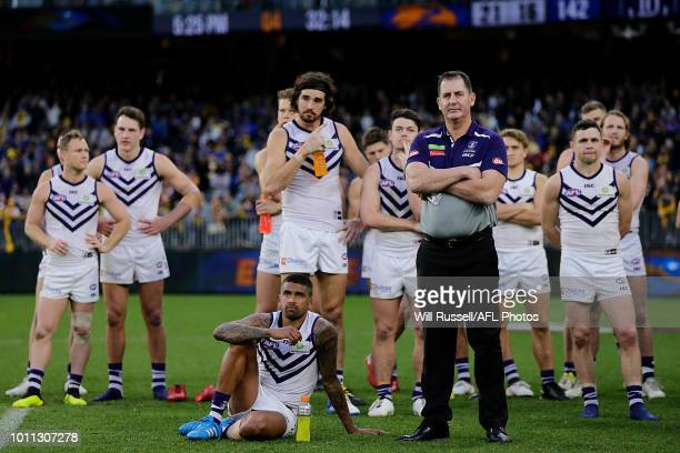 The Dockers look on during the GlendinningAllan Medal presentation during the round 20 AFL match between the West Coast Eagles and the Fremantle...