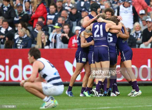 The Dockers players celebrate winning on the final siren next to Andrew Mackie of the Cats during the Second AFL Qualifying Final match between the...