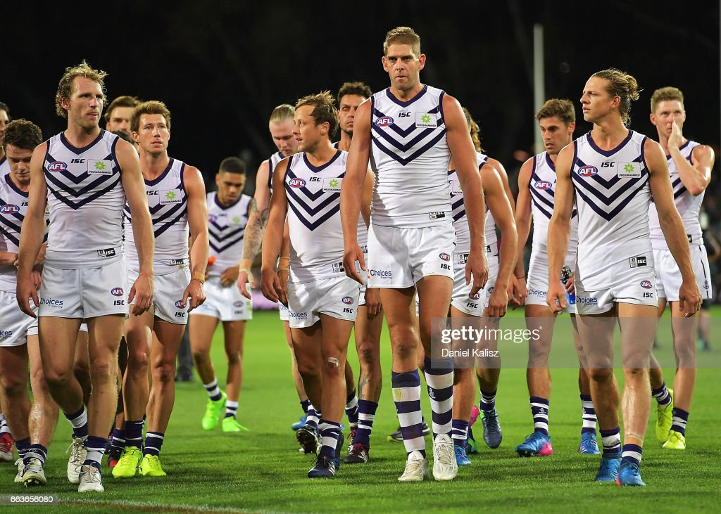 The Dockers players walk from the field after the round two AFL match between the Port Adelaide Power and the Fremantle Dockers at Adelaide Oval on April 2, 2017 in Adelaide, Australia.