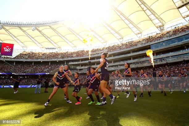 The Dockers run onto the field during the round two AFLW match between the Fremantle Dockers and the Collingwood Magpies at Optus Stadium on February...