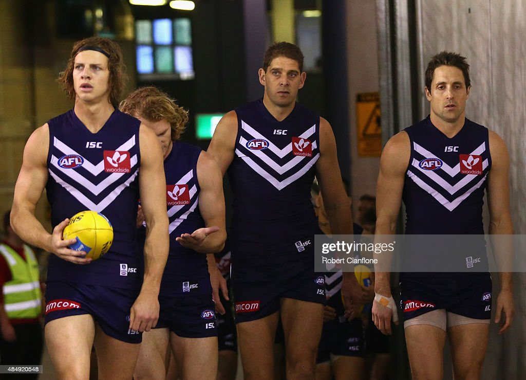 The Dockers walk out for the round 21 AFL match between the North Melbourne Kangaroos and the Fremantle Dockers at Etihad Stadium on August 23, 2015 in Melbourne, Australia.