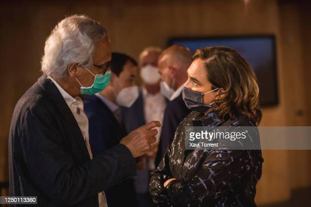 The doctor Bonaventura Clotet and the Mayoress of Barcelona Ada Colau speak during the Institutional Opening of CASA SEAT on June 16 2020 in...