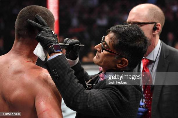 The doctor interacts with Nate Diaz between rounds of his welterweight bout against Jorge Masvidal for the BMF title during the UFC 244 event at...