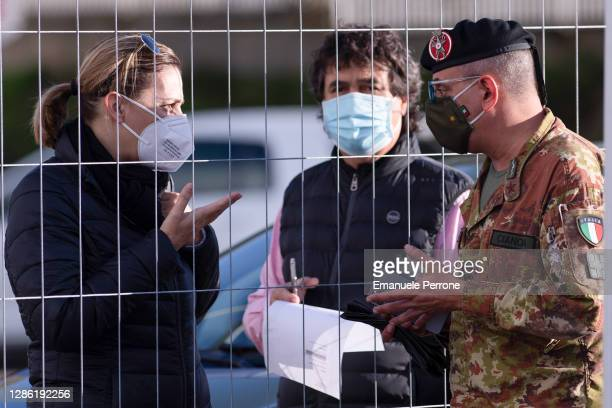 "The Doctor of the Italian Army, who is charge of Operation ""IGEA"" in Sardinia, talks to citizens for information on how to swab for COVID-19 on..."