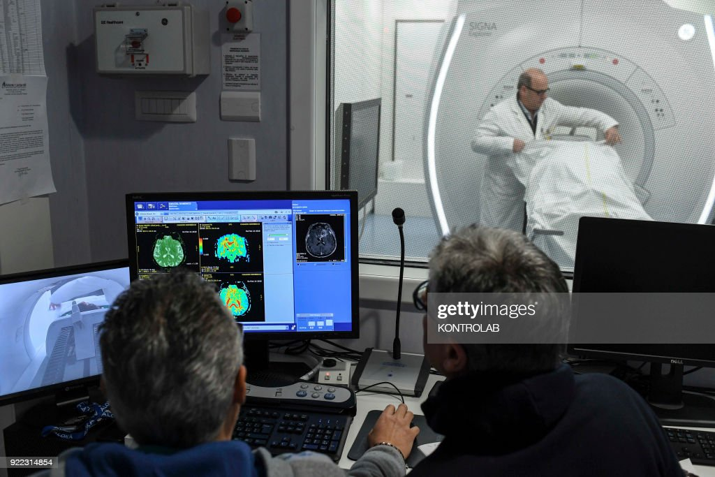 The doctors and patient an internal, new technology resonance room, inside the hospital Antonio Cardarelli in Naples, Campania region, southern Italy.