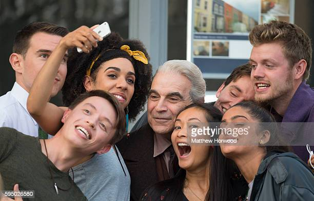 The Doctor's companion Pearl Mackie takes a selfie with extras and actor David Suchet star of Poirot during filming for the 10th series of Doctor Who...