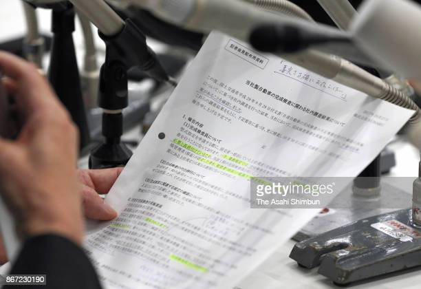 The document Subaru Corp President and CEO Yasuyuki Yoshinaga holds during a press conference on October 27 2017 in Tokyo Japan Subaru let...