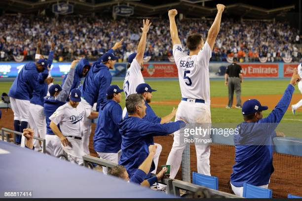 The Dodgers bench reacts to a Joc Pederson solo home run in the seventh inning during Game 6 of the 2017 World Series against the Houston Astros at...