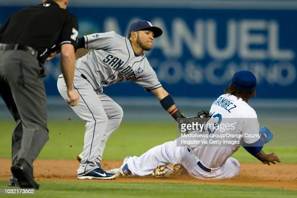 The Dodgers' Hanley Ramirez is out trying to steal second as the Padres Alexi Amarista applies the tag in the first inning Monday night at Dodger...
