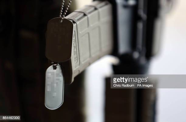 S DOG TAGS AS REQUESTED BY THE USAF The dog tags of Captain Sean Ruane rest on a rifle during a memorial service at RAF Lakenheath to honour the four...