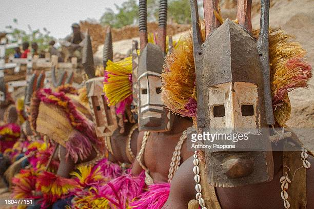 The Dogon perform with their dancing masks to honor the passing of a respected elder, ceremony dogon masks that evoke the behavior of some of the...