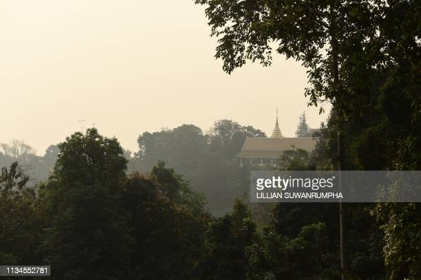The Doi Suthep Buddhist temple is seen covered under a smog in the northern Thai province of Chiang Mai on April 3 2019 The city has far eclipsed...