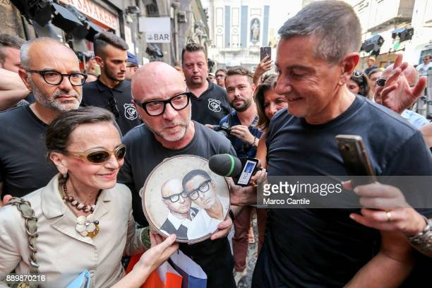 The Dolce Gabbana stylists walking around San Gregorio Armeno in Naples receive a tambourine with their faces in homage