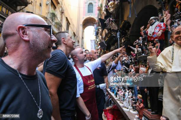 The Dolce Gabbana stylists walking around San Gregorio Armeno in Naples they look at the statues of the Neapolitan nativity scene
