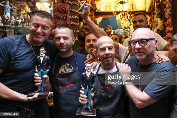 The Dolce Gabbana stylists walking around San Gregorio Armeno in Naples with their figurines created by a crib artisan