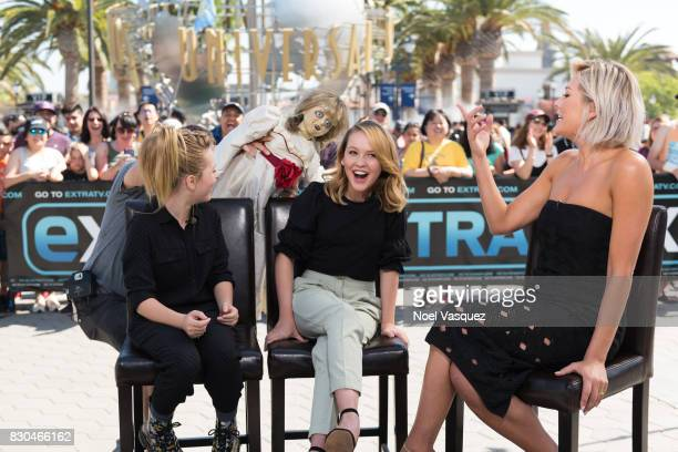 The doll from the film Annabelle surprises Lulu Wilson Talitha Bateman and Charissa Thompson at Extra at Universal Studios Hollywood on August 11...