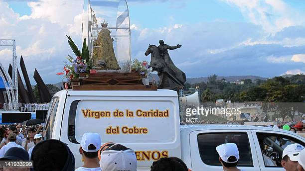 The dolllike statue of the Our Lady of Charity of Cobre makes its way through the throngs gathered in Santiago Cuba to hear Pope Benedict XVI...