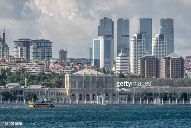 The Dolmabahce Palace dolmabahce palace rises on the shores of the Bosphorus Strait before the modern skyline of Istanbul, Turkey, on 8 August 2018.