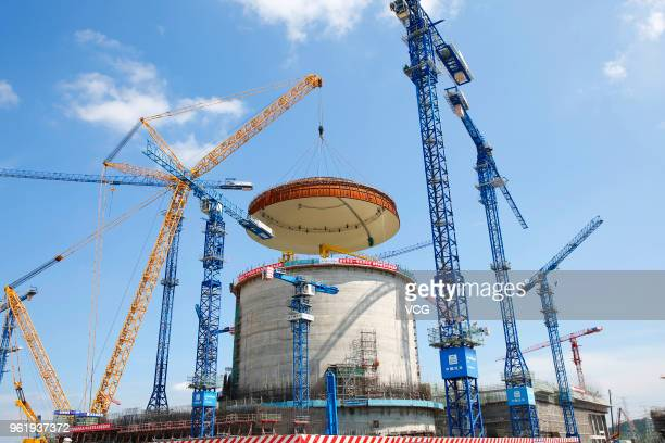 The dome is hoisted onto the reactor building at the construction site of the Fangchenggang Nuclear Power Plant Unit 3 on May 23, 2018 in Fangcheng,...