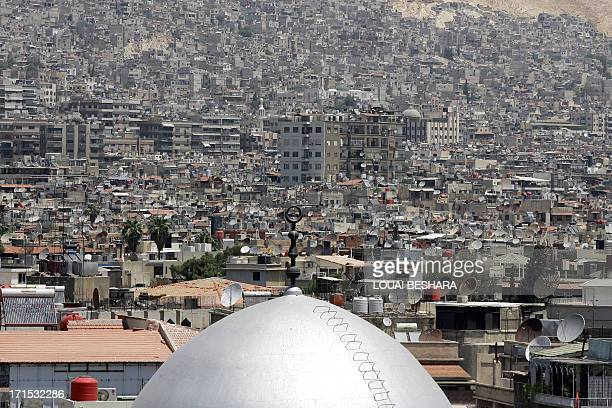 The dome of a mosque is seen amongst satellite dishes on the rooftops of home and apartment blocks in the Syrian capital Damascus on June 26 2013 AFP...