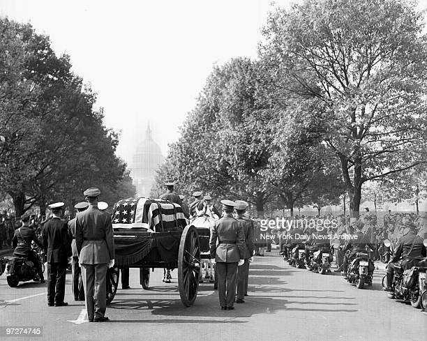 The Dome of the Capitol where Roosevelt added memorable pages to history looms in background while procession halts momentarily during Franklin D...