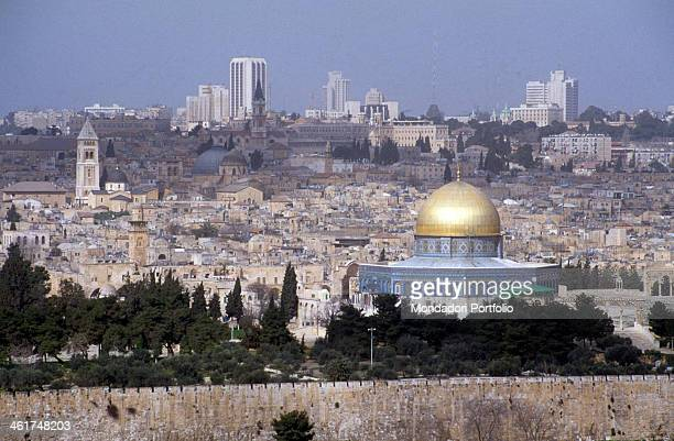 The Dome of the Rock dominating the panoramic view of Jerusalem surrounded by the trees on the Temple Mount in the background are the Lutheran Church...