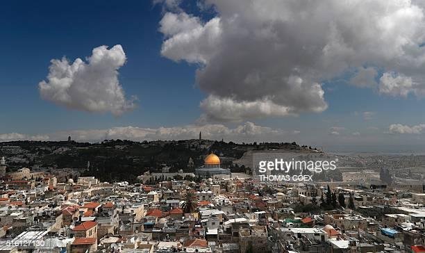 TOPSHOT The Dome of the Rock is seen on the AlAqsa mosque compound is seen surrounded by houses in Jerusalem's Old City with the Mount of Olives in...