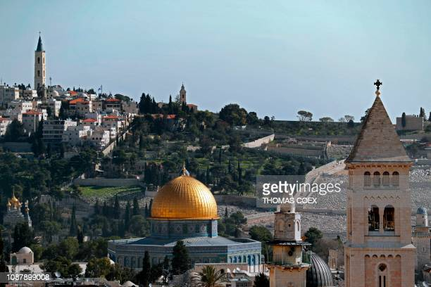 The Dome of the Rock situated in the alAqsa mosque compound is seen from Jerusalem's Old City with the belltower of the Lutheran Church of the...