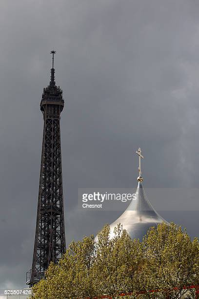 The dome of the Russian Orthodox Cathedral SainteTrinite at the Russian Orthodox Spiritual and Cultural Centre is seen in front of the Eiffel tower...