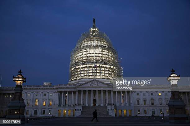 The dome of the US Capitol building is illuminated before sunrise in Washington DC US on Friday Dec 11 2015 The Senate passed a stopgap measure on...