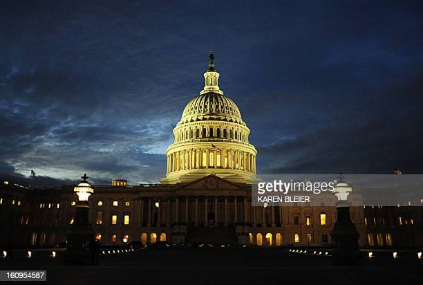 The dome of the US Capitol is seen at dusk on December 9 2008 in Washington DC AFP PHOTO/Karen BLEIER