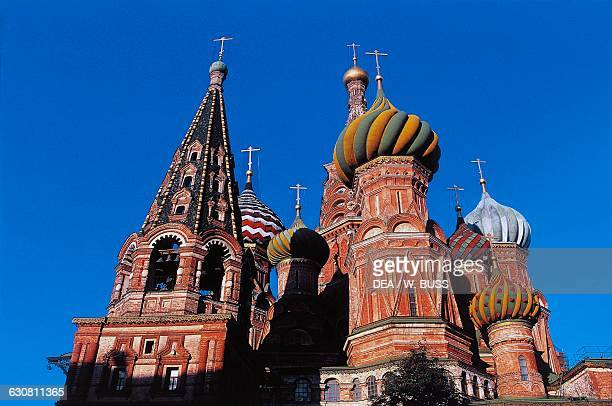 The domes of Saint Basil's Cathedral 15551561 the first light of evening Red Square Moscow Russia 16th century