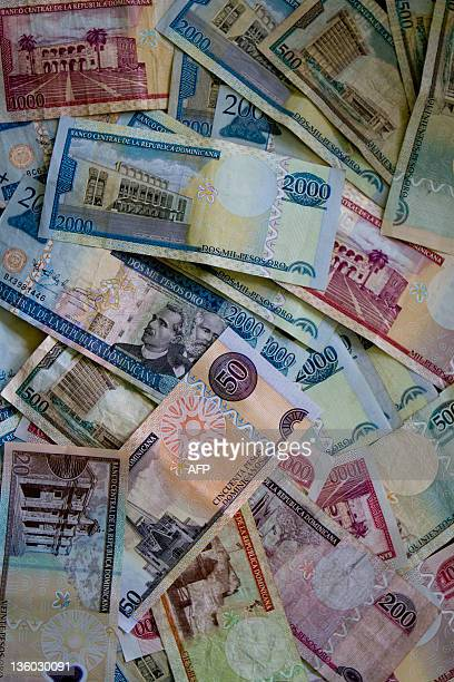 The Dominican currency 'pesos' banknotes on December 20 2011 in Santo Domingo AFP PHOTO/ERIKA SANTELICES