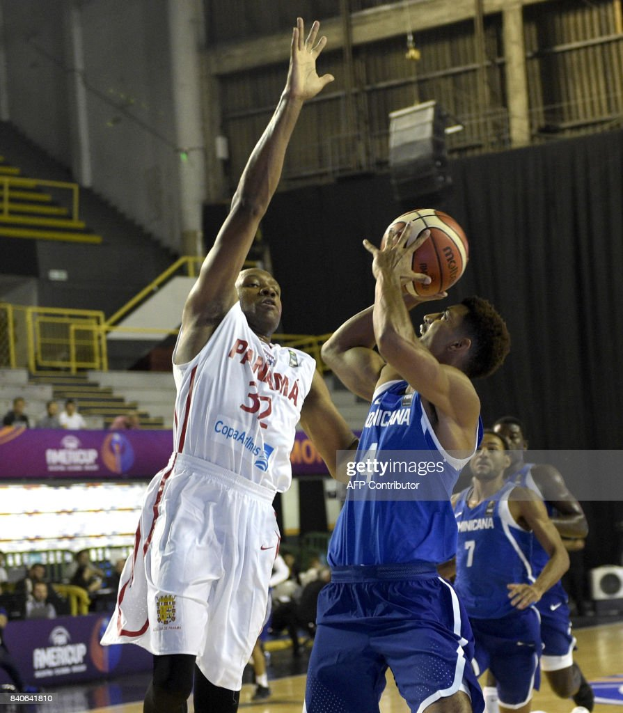 The Dominican Republic's Gelvis Solano (R) vies for the ball with Panama's Javier Carter during their 2017 FIBA Americas Championship basketball match in Montevideo, on August 29, 2017. /