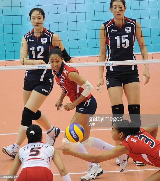 The Dominican Republic's Lisvel Elisa Eve Mejia dives for a return as teammates Milagros Cabral de la Cruz Brenda Castillo South Korea's Hwang...