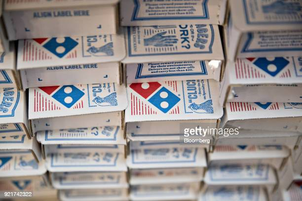 The Domino's Pizza Inc logo is seen on boxes at the company's restaurant in Chantilly Virginia US on Tuesday Feb 20 2018 Domino's released earnings...