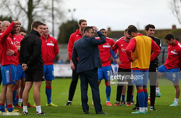 The Doncster squad look on after the match was postponed during the FA Cup First Round match between WestonSuperMare and Doncaster Rovers on November...