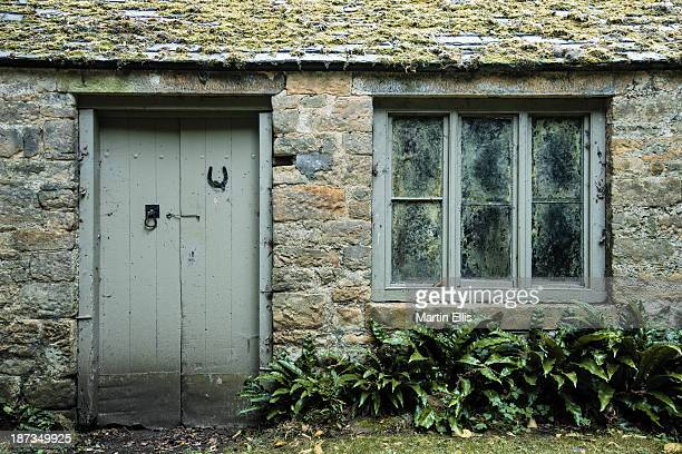 CONTENT] The door and window of an outhouse near the stables at Cheeseburn Grange Taken during an open day to raise money for Maggies Centres a...