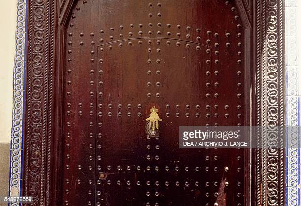 The door of a house in Tangier and door knocker in the shape of the Hand of Fatima or Khamsa Morocco