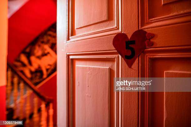 The door of an empty room is pictured in the closed brothel 'X-Carree' in Halle/Saale, eastern Germany, on April 7 where many activities have been...