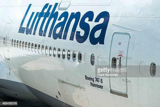The door of the parking Boeing 747 Hannover of the airline Lufthansa at Frankfurt International Airport